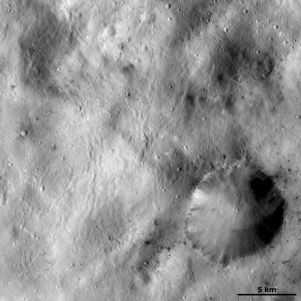 Spots of Dark Material Surrounding an Impact Crater