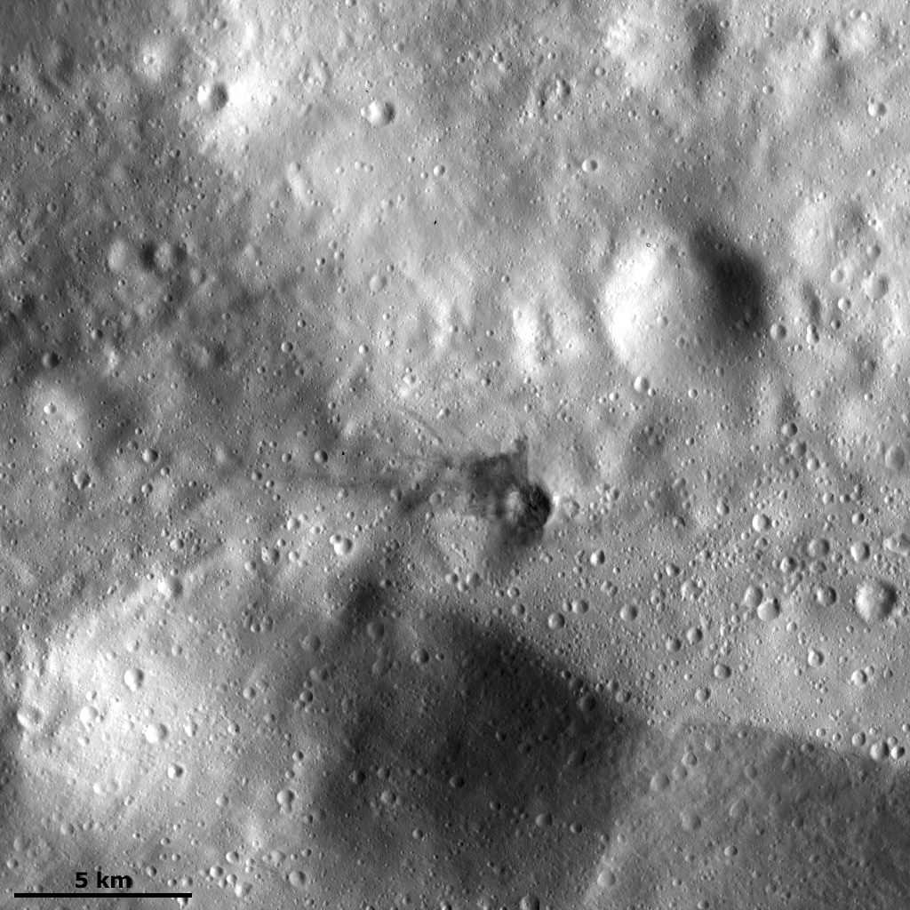 Dark Material in the Ejecta of a Small Crater