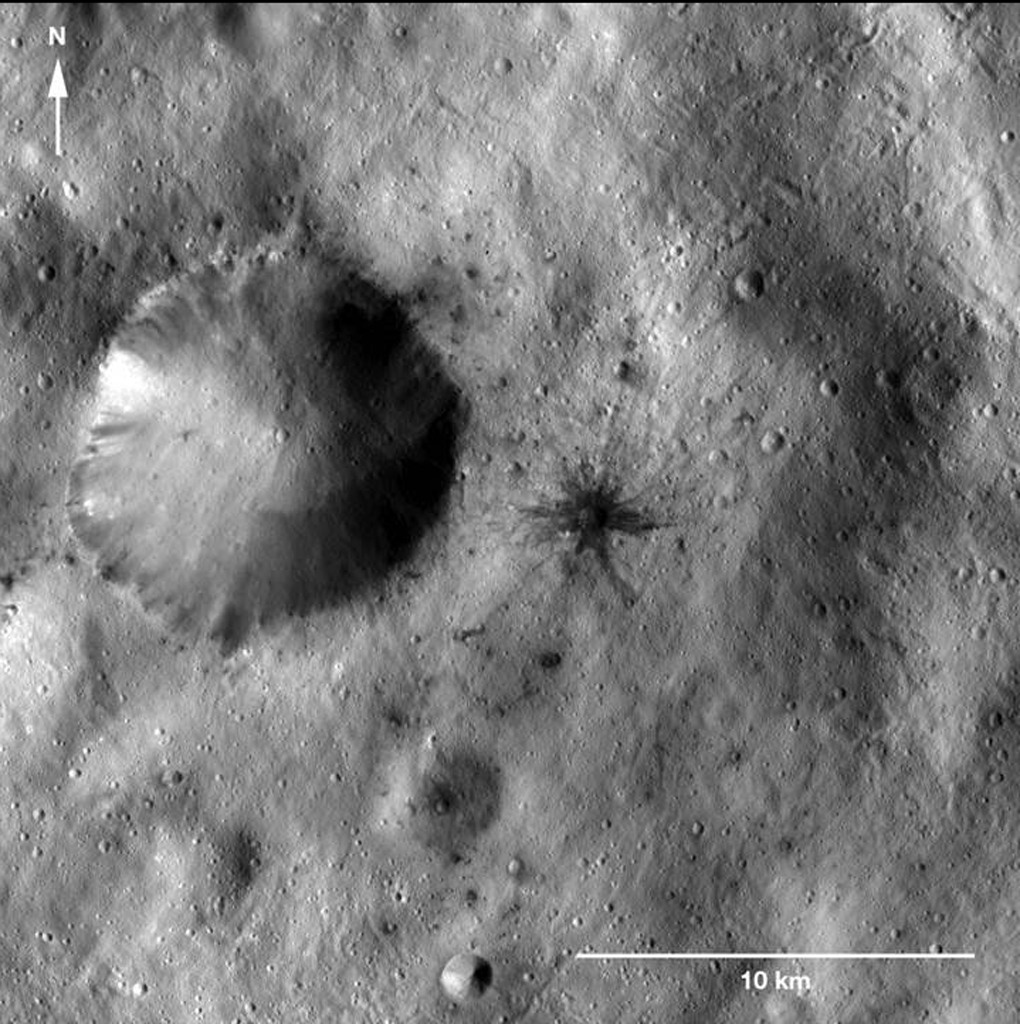 Dark-Rayed Crater and Spots