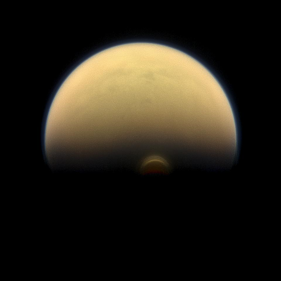 Slipping into shadow, the south polar vortex at Saturn's moon Titan still stands out against the orange and blue haze layers that are characteristic of Titan's atmosphere.