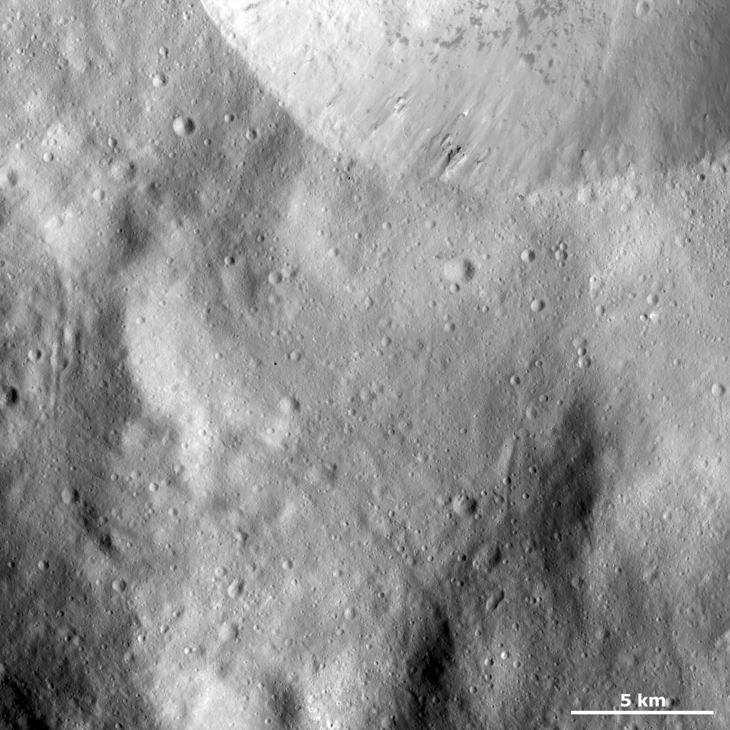 Sharp Crater Rim with Dark Material and Boulders