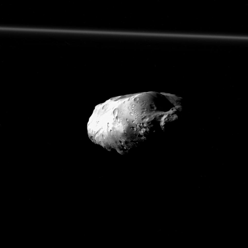 NASA's Cassini spacecraft spied details on the pockmarked surface of Saturn's moon Prometheus (86 kilometers, or 53 miles across) during a moderately close flyby on Dec. 6, 2015.