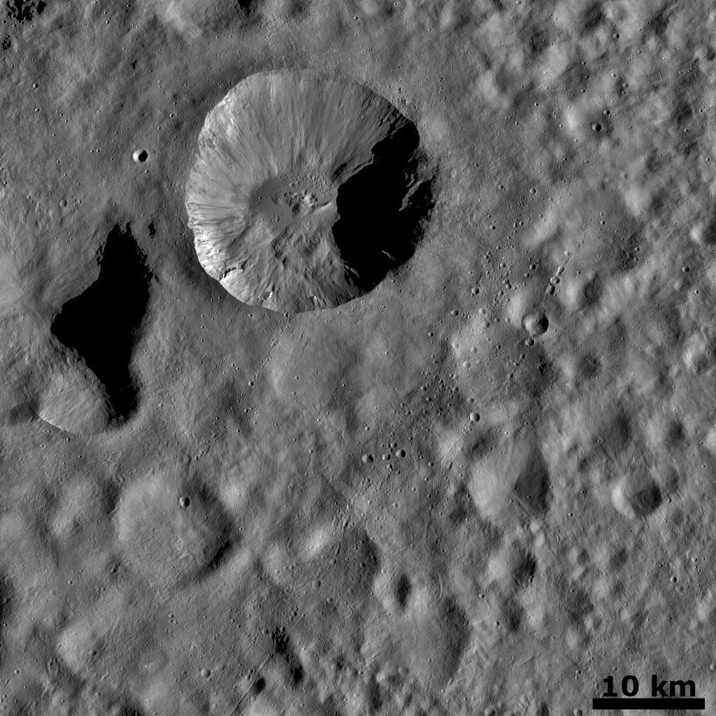 Ejecta from a Fresh Crater Covering Older Craters and Crater Chains