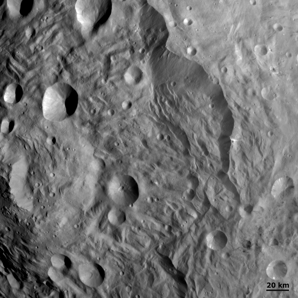 Scarps, Hummocky Terrain and Impacts at Vesta's South Pole