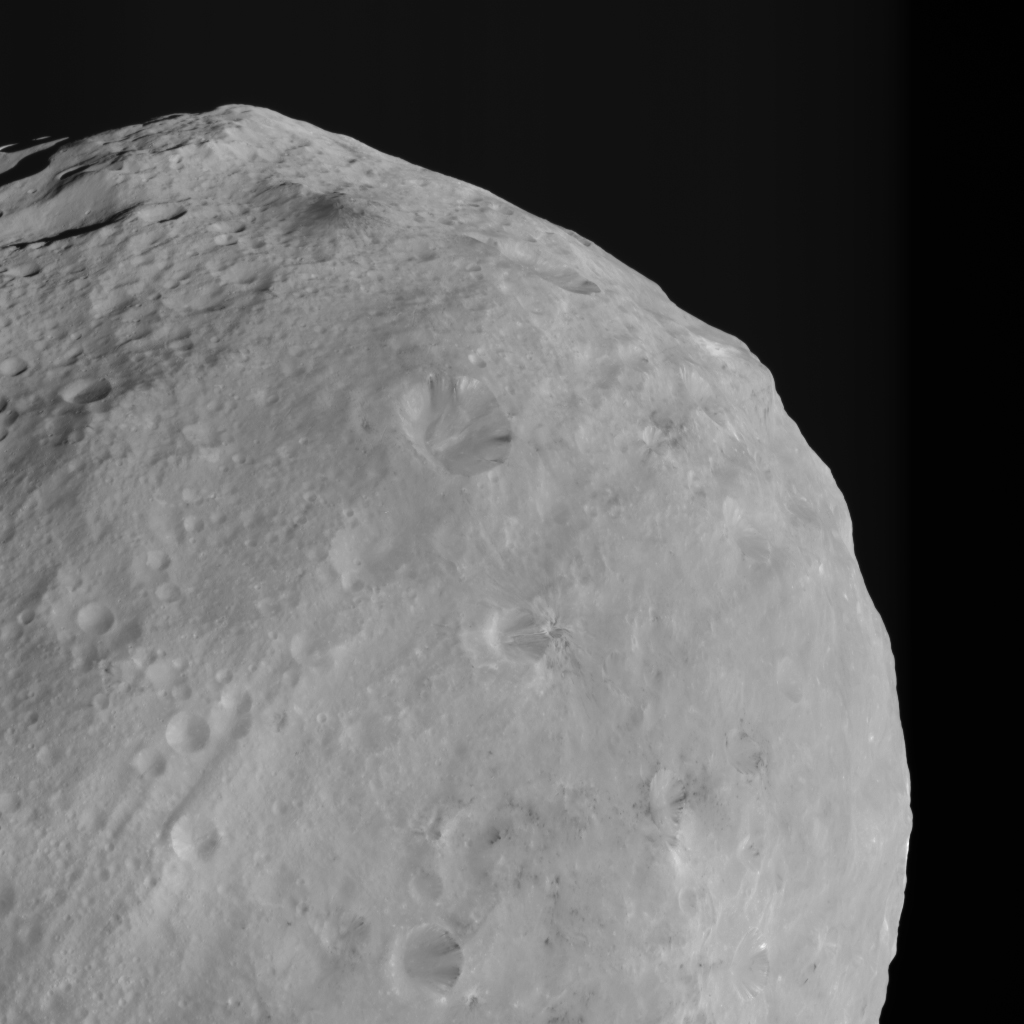 Mountains and Bright and Dark Material on Vesta