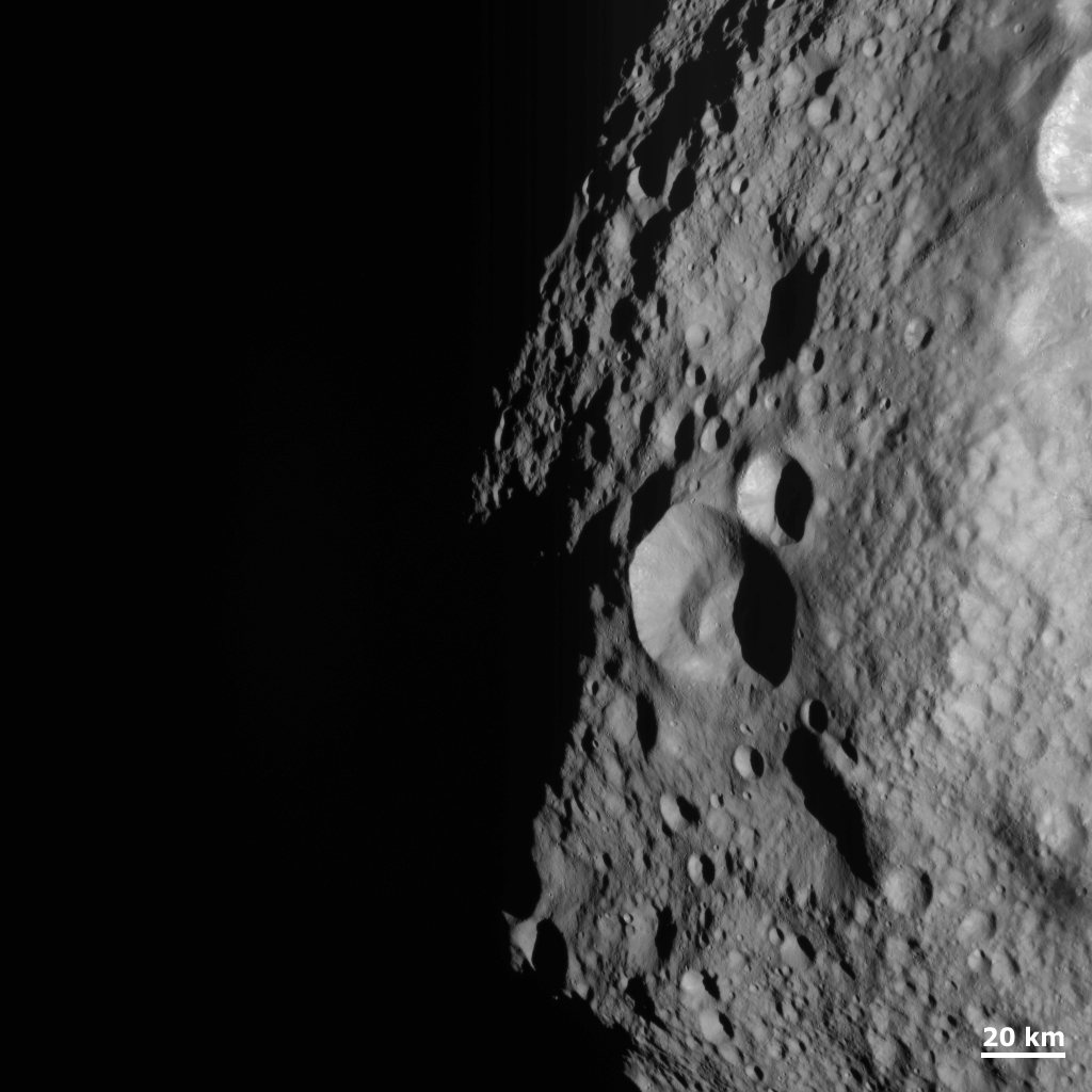 Young and Old Crater at the Night and Day Boundary on Vesta