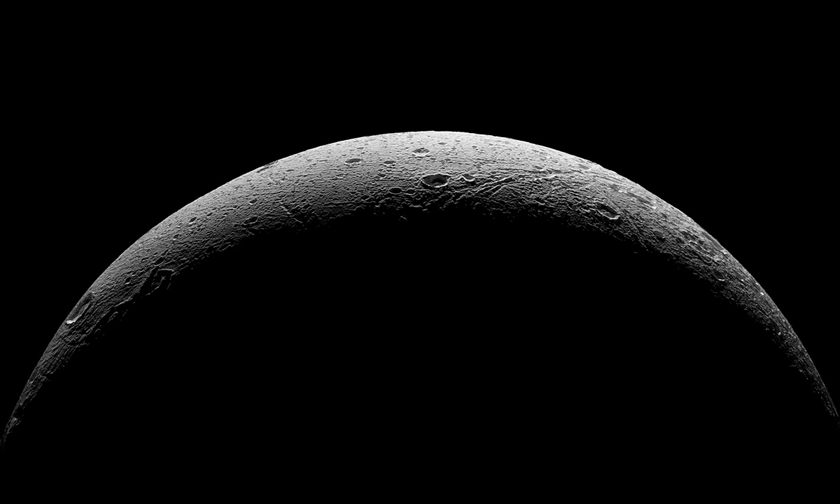 NASA's Cassini spacecraft captured this parting view showing the rough and icy crescent of Saturn's moon Dione following the spacecraft's last close flyby of the moon on Aug. 17, 2015.