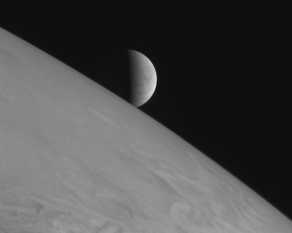 New Horizons took this image of the icy moon Europa rising above Jupiter's cloud tops with its Long Range Reconnaissance Imager (LORRI) at 11:48 Universal Time on February 28, 2007, six hours after the spacecraft's closest approach to Jupiter.