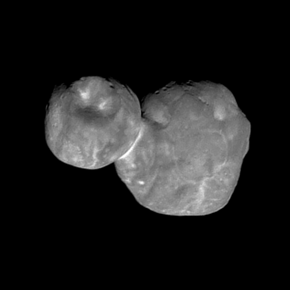 black and white view of two-lobed object in dark space