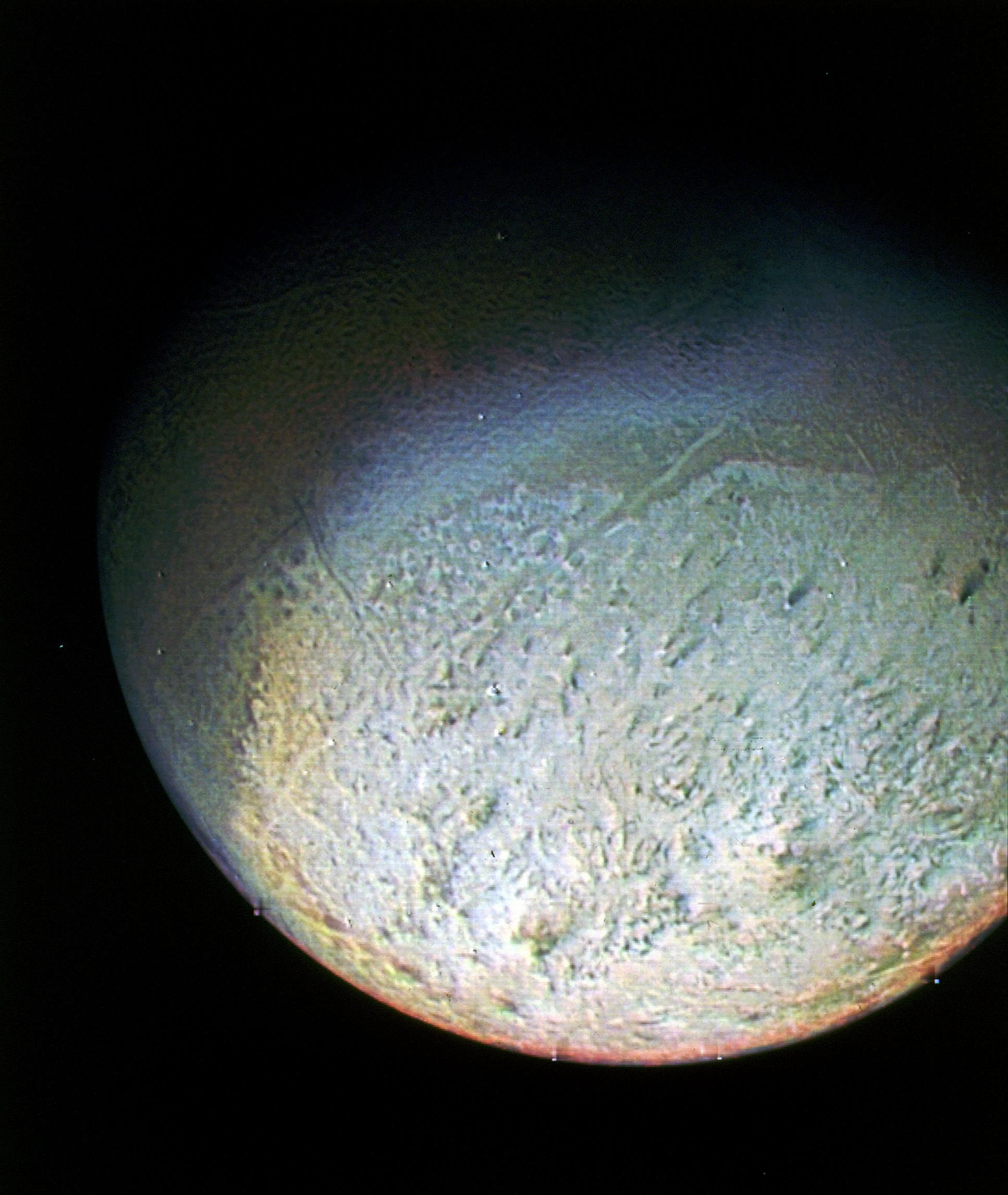 This color photo of Neptune's large satellite Triton was obtained on Aug. 24 1989 at a range of 530,000 kilometers (330,000 miles).
