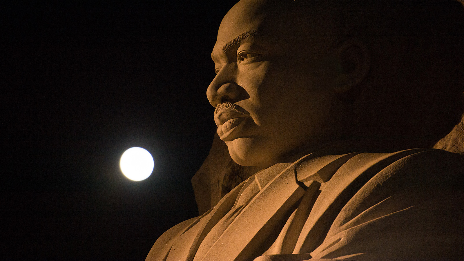 Full Moon over giant statue of the Martin Luther King Jr.