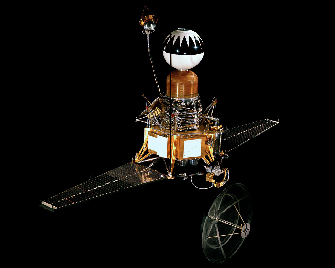Photo of spacecraft with a black background.