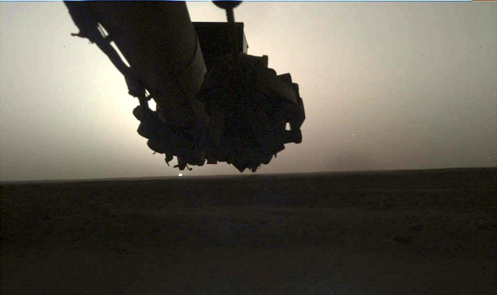 Two images showing the Sun rising and setting on Mars. The Sun is a small orb on the horizon.