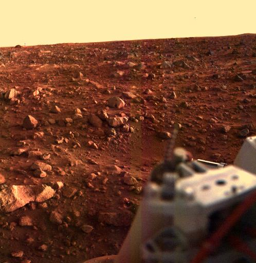 A rocky, red plain on Mars in twilight.