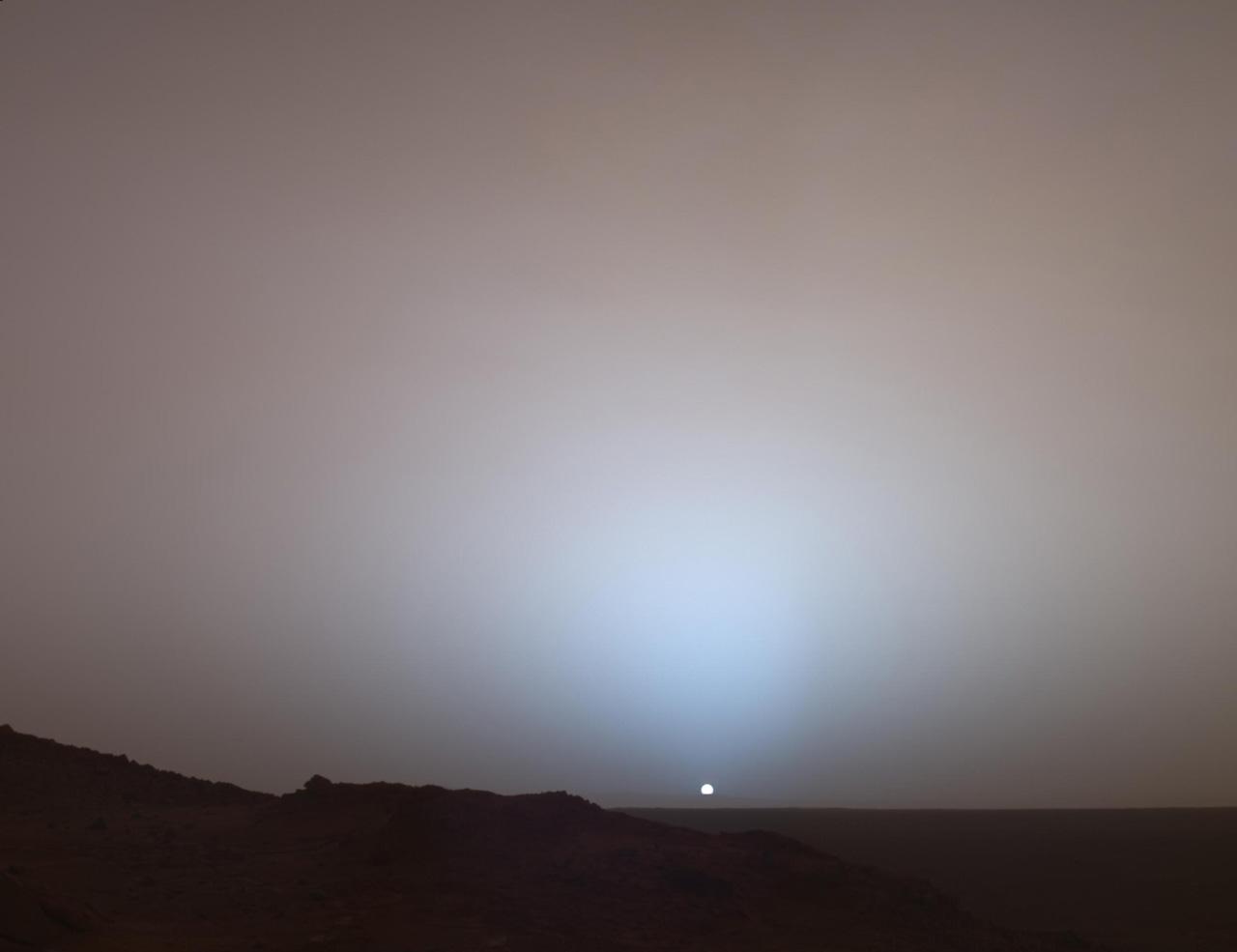Small sun on the horizon of Mars.