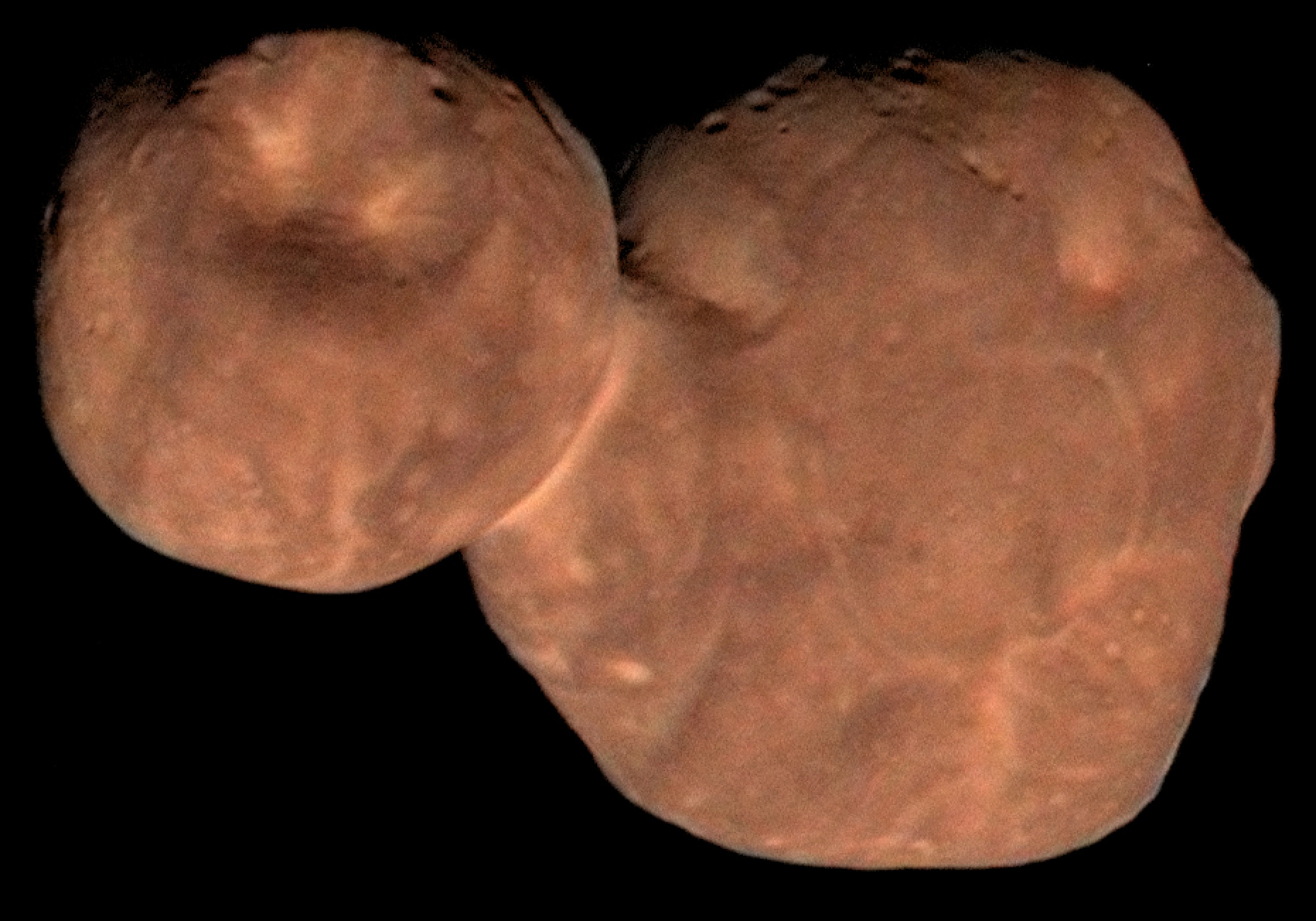 reddish, cratered object with two attached lobes