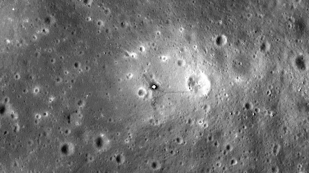 lunar surface seen from above with Apollo hardware visible as small objects