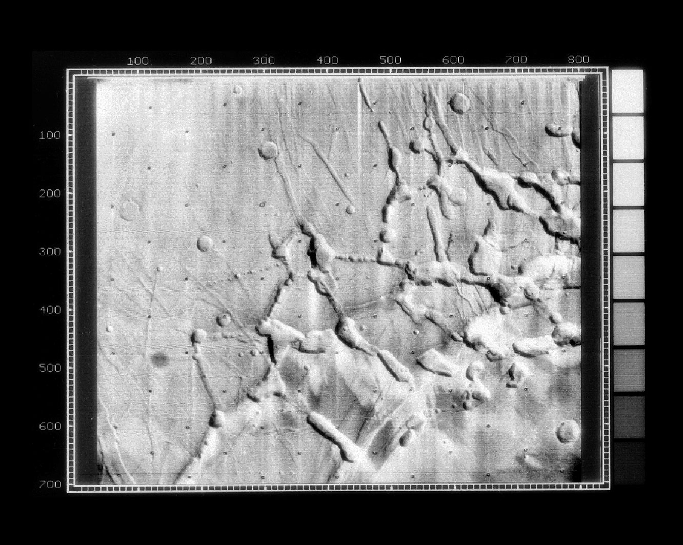 "Mariner 9's view of the ""labyrinth"" at the western end of Vallis Marineris on Mars."