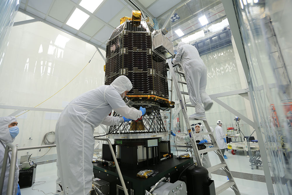 NASA's Lunar Atmosphere and Dust Environment Explorer (LADEE) spacecraft being prepared in the clean room at Wallops Flight Facility.