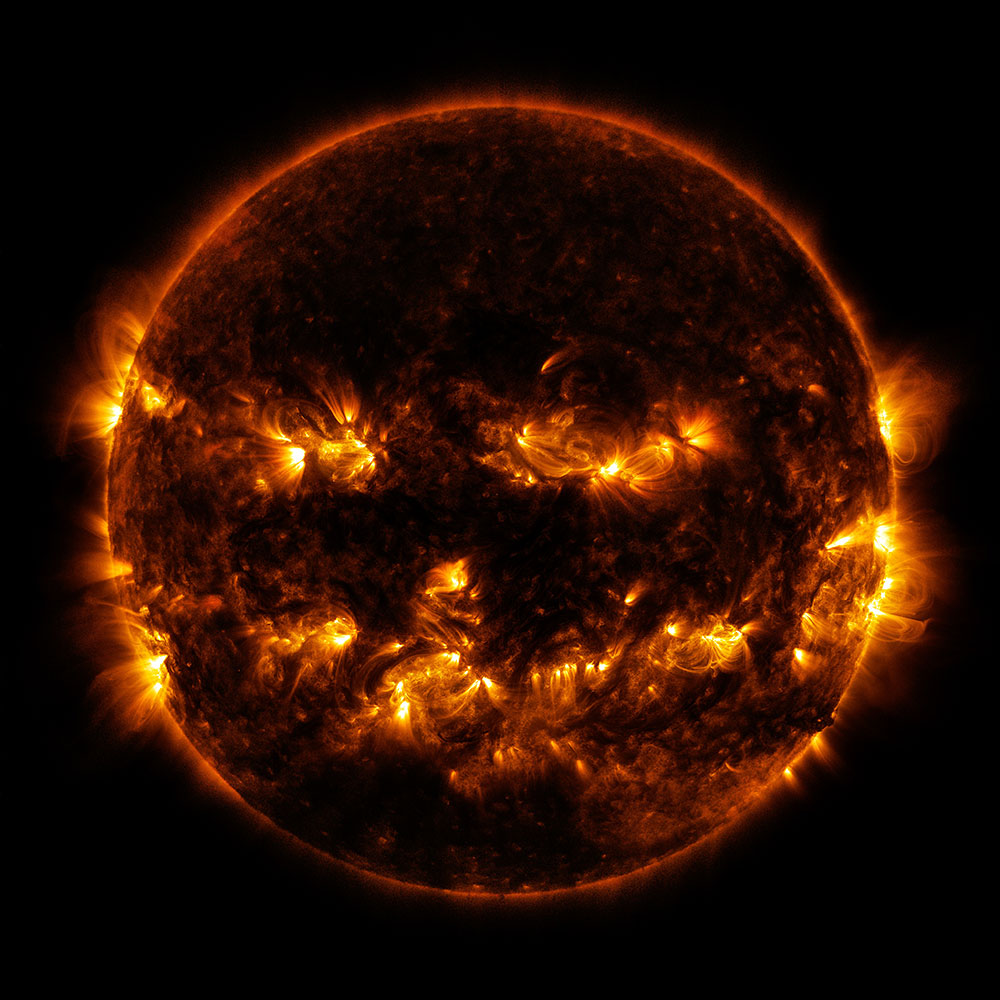 Active regions on the Sun give it the appearance of a jack-o'-lantern. This image is a blend of 171 and 193 angstrom light as captured by the Solar Dynamics Observatory.