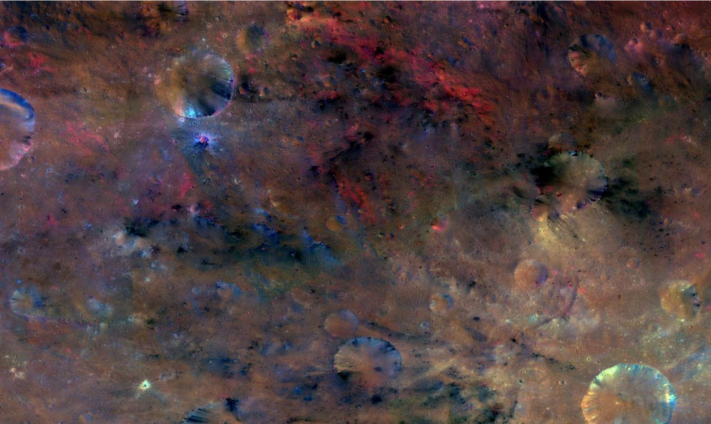 This colorful image from NASA's Dawn mission shows material northwest of the crater Sextilia on the giant asteroid Vesta. Sextilia, located around 30 degrees south latitude, is at the bottom right of this image.