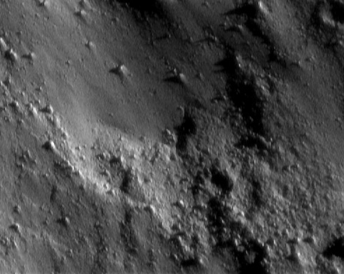 NEAR Shoemaker took this picture at 8:45 p.m. EST on January 25, 2001, during one of the spacecraft's low-altitude passes over the surface of Eros.