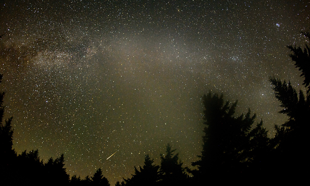 In this 30 second exposure, a meteor streaks across the sky during the annual Perseid meteor shower Friday, August 12, 2016 in Spruce Knob, West Virginia.