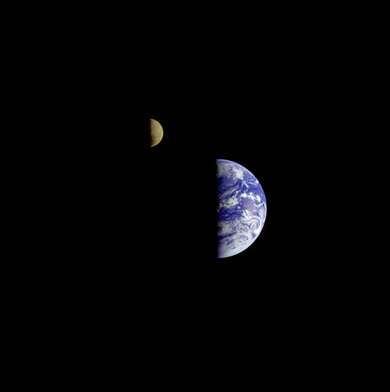 Eight days after its final encounter with the Earth, the Galileo spacecraft looked back and captured this remarkable view of the Earth and Moon.
