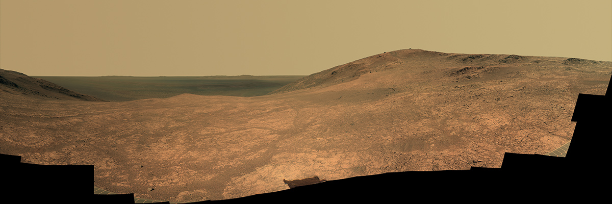 """Marathon Valley"" on Mars opens northeastward to a view across the floor of Endeavour Crater in this scene from the panoramic camera (Pancam) of NASA's Mars Exploration Rover Opportunity."
