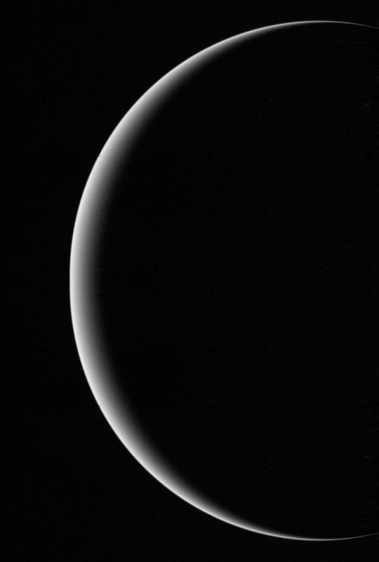 This image shows a crescent Uranus, a view that Earthlings never witnessed until Voyager 2 flew near and then beyond Uranus on January 24, 1986.