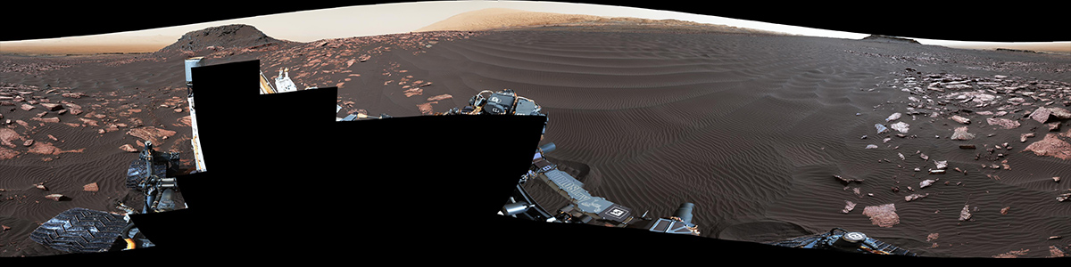 "A rippled linear dune of dark Martian sand, ""Nathan Bridges Dune,"" dominates this full-circle panorama from the Mast Camera (Mastcam) of NASA's Curiosity Mars rover."
