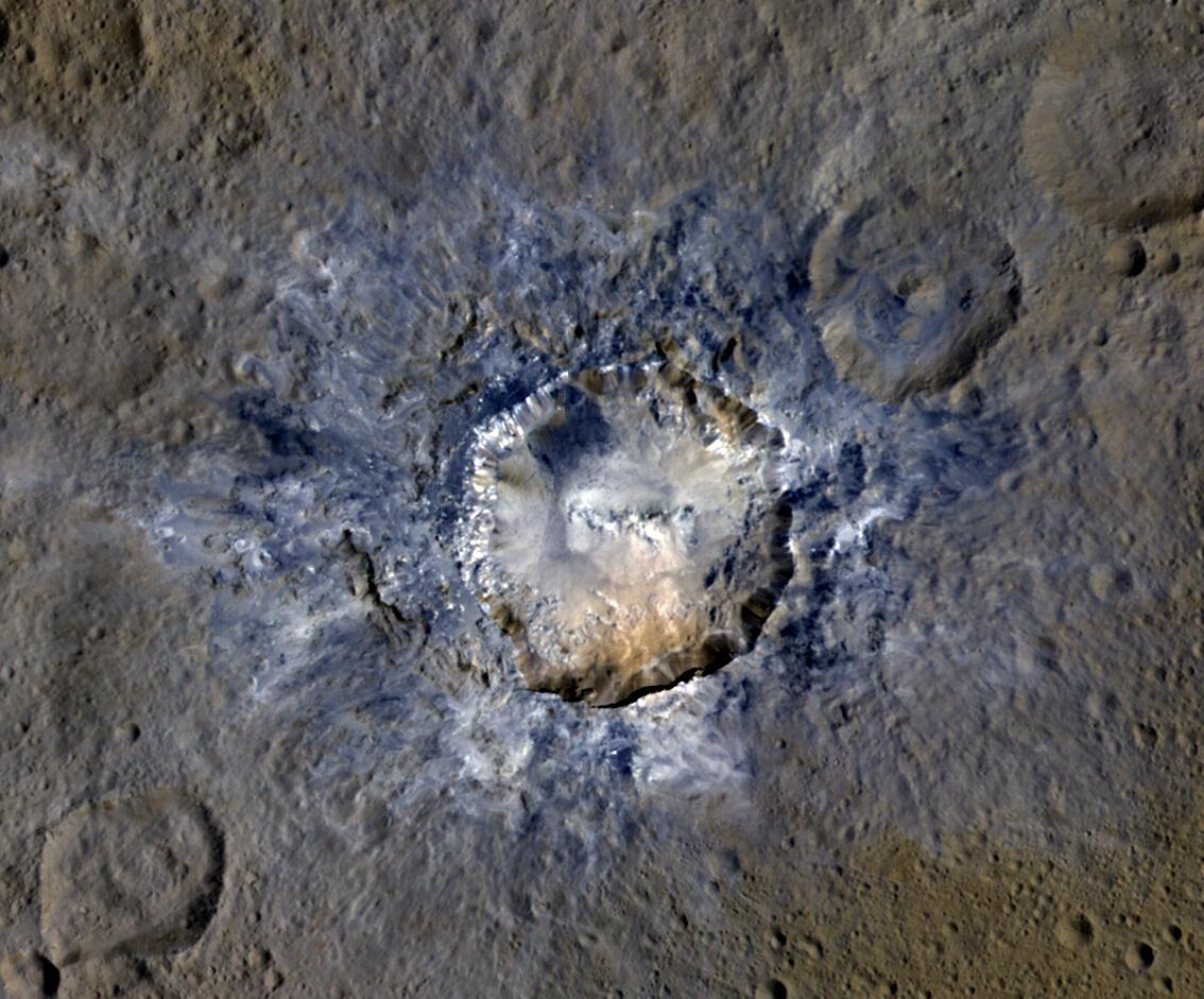 Ceres' Haulani Crater, with a diameter of 21 miles (34 kilometers), shows evidence of landslides from its crater rim.