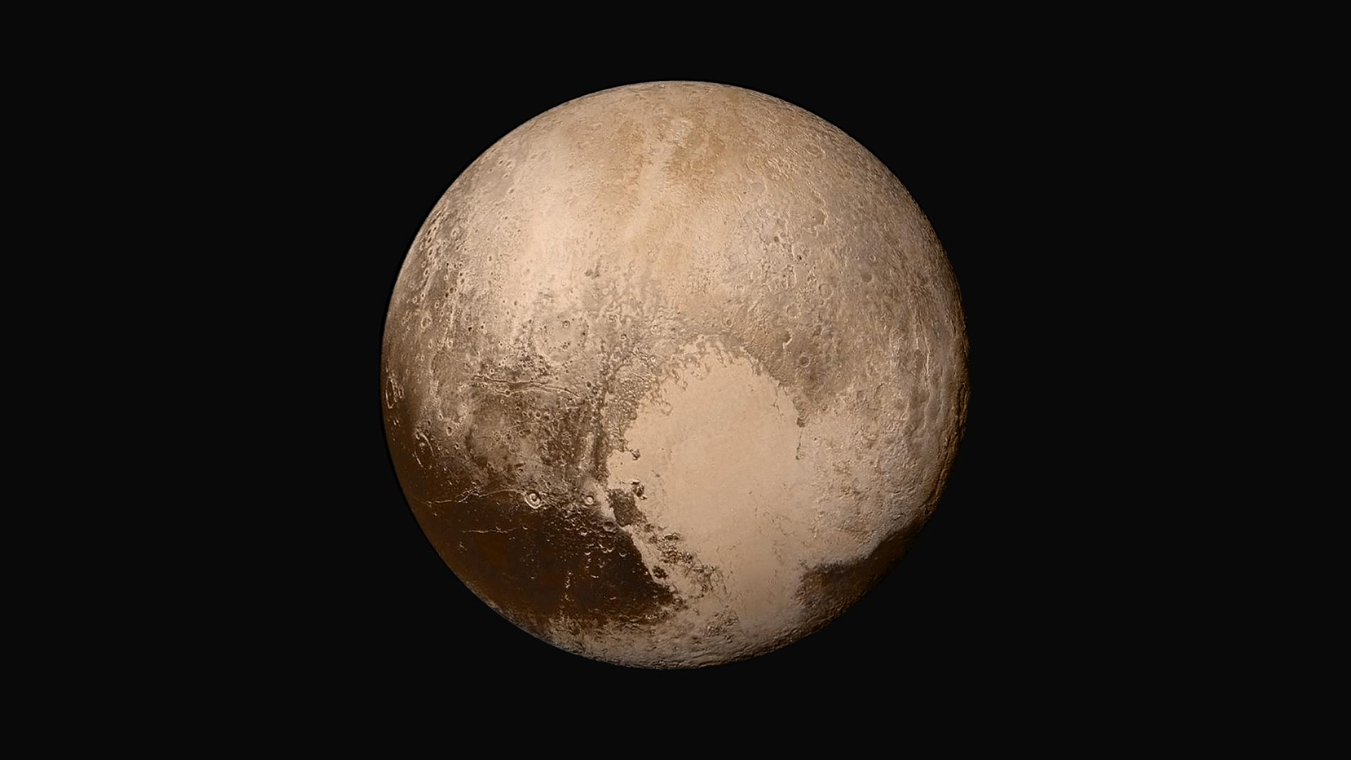 Four images from NASA's New Horizons' Long Range Reconnaissance Imager (LORRI) were combined with color data from the Ralph instrument to create this global view of Pluto.