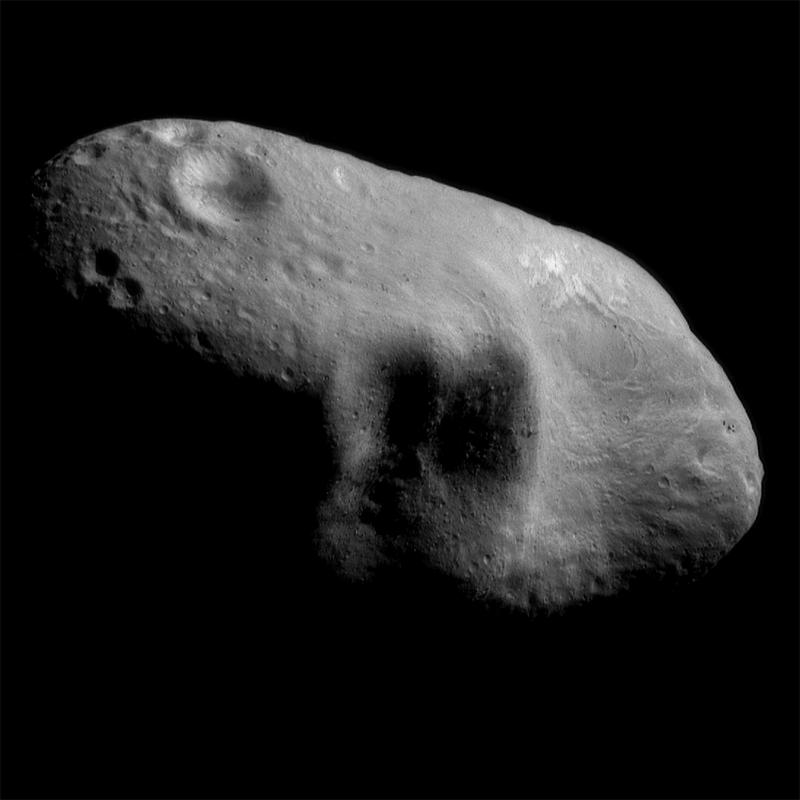 Black and white picture of shadowed feature on asteroid Eros