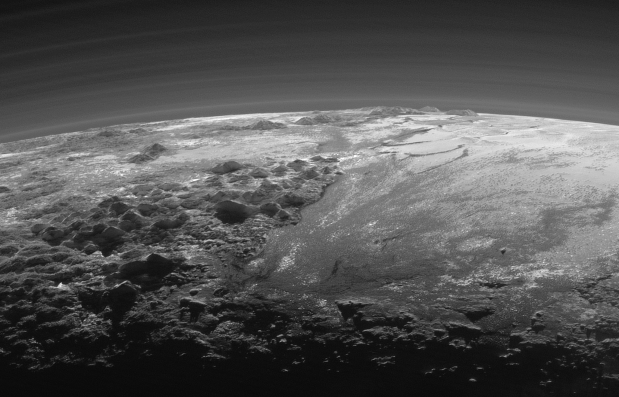 Pluto's mountains, frozen plains and foggy hazes