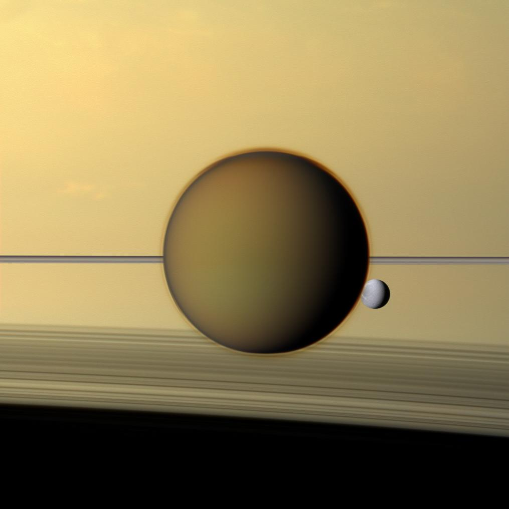 Natural color image of Titan and Dione in front of Saturn's rings