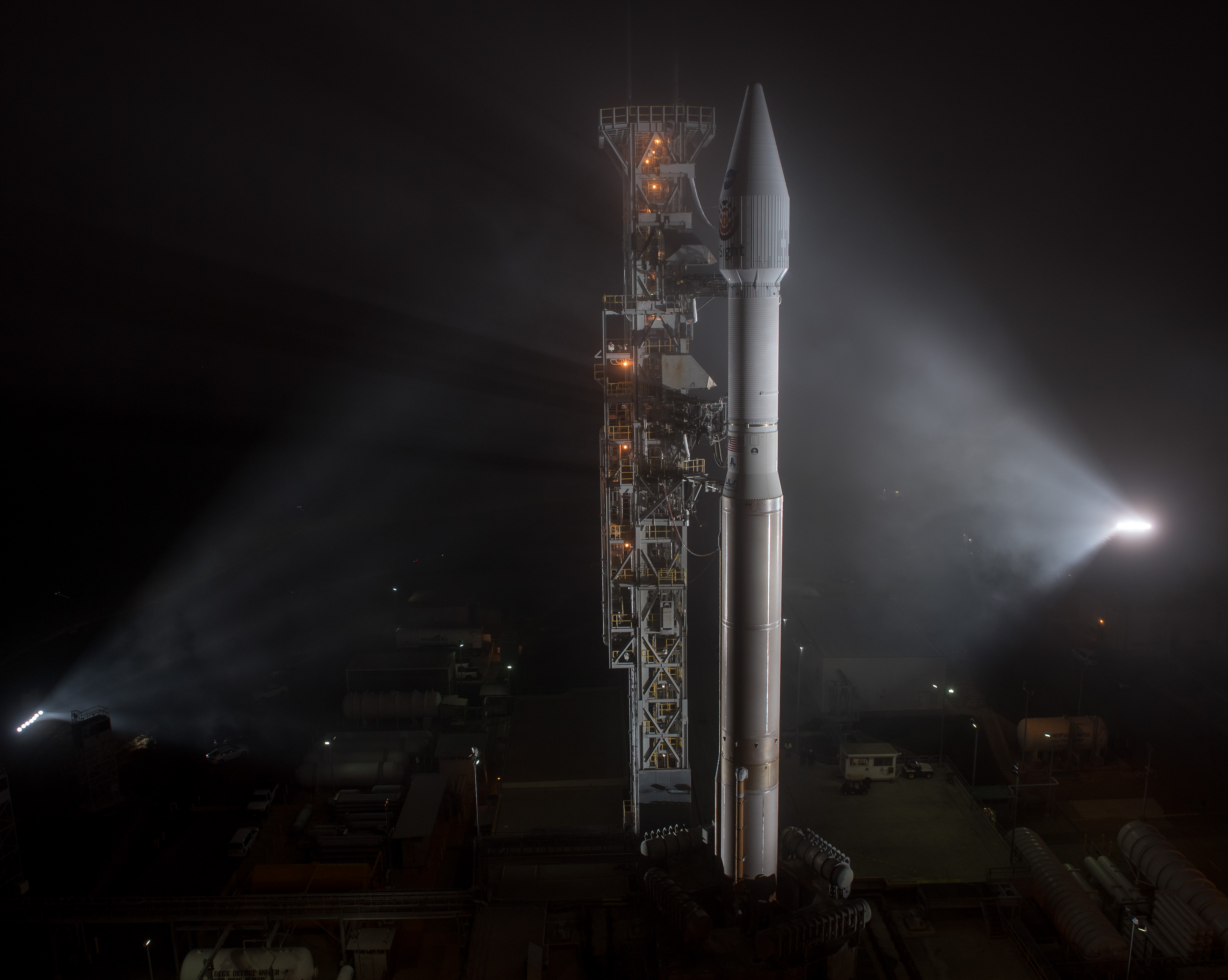 Spotlights on rocket on the launchpad.