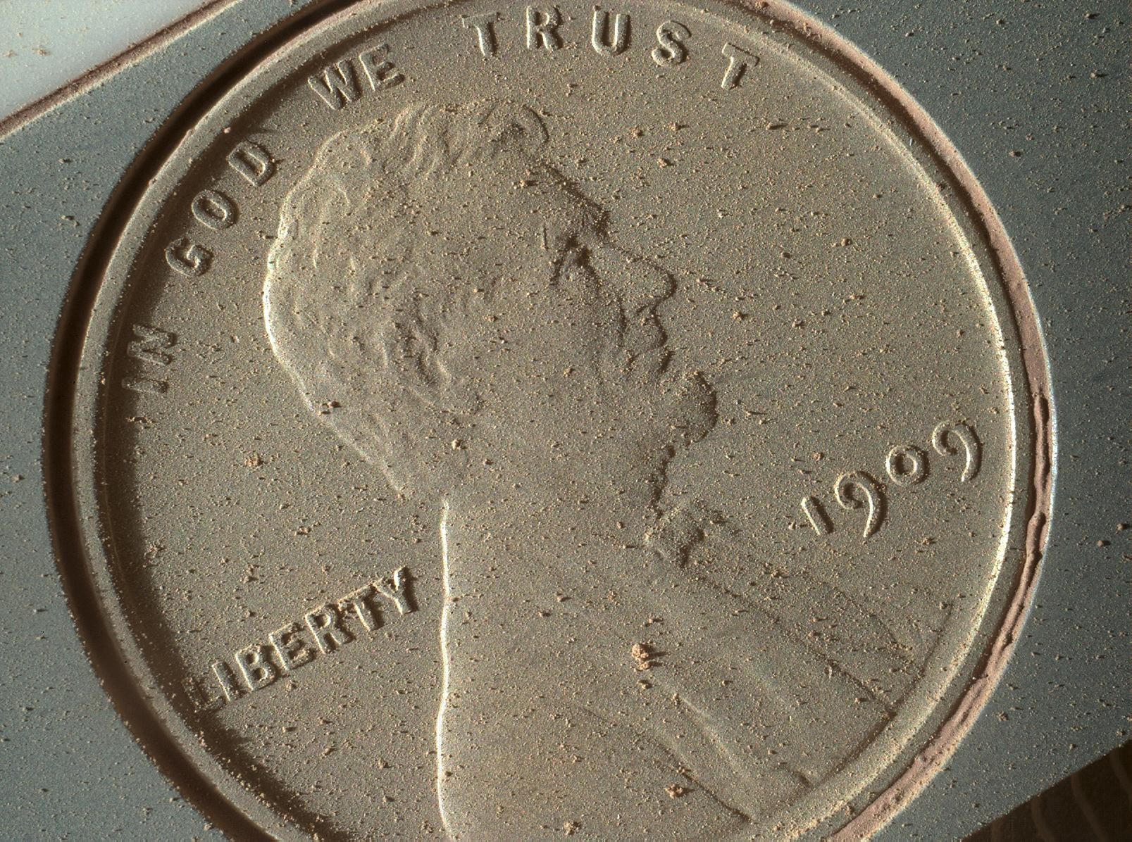 Penny covered with Martian dust.