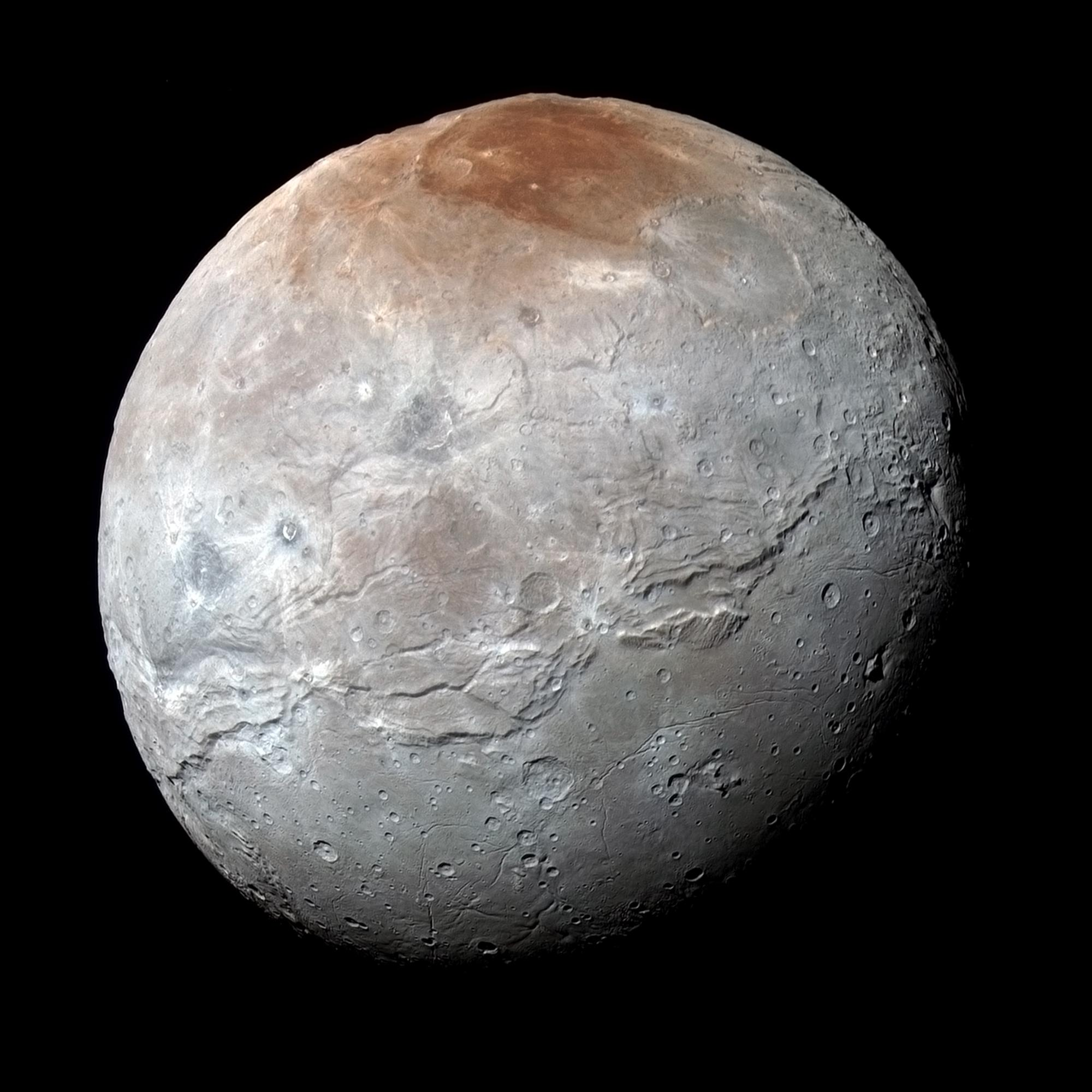 Enhanced color image showing surface details of moon Charon.
