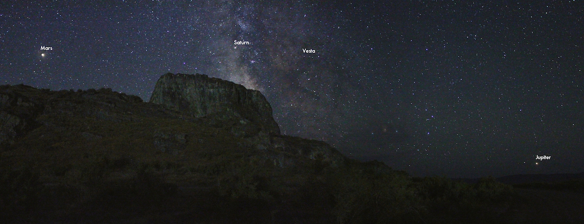 planets along the horizon in photo of night sky