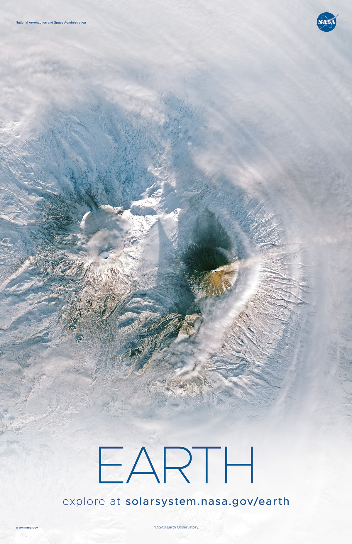 Orbital view of smoking volcano amid snowcapped peaks.