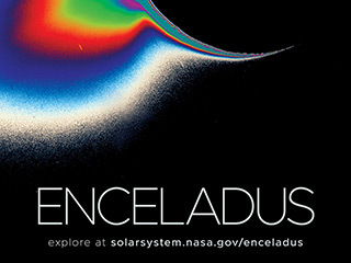 Enhanced color view shows massive plume erupting from the crescent of Enceladus.