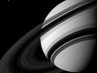 Tethys alongside Saturn