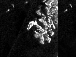These three images, created from Cassini Synthetic Aperture Radar (SAR) data, show the appearance and evolution of a mysterious feature in Ligeia Mare, one of the largest hydrocarbon seas on Saturn