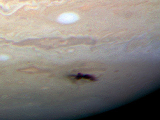 Comet or Asteroid Impact on Jupiter (2009)