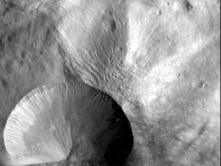 Asteroid Vesta: Layered Young Crater