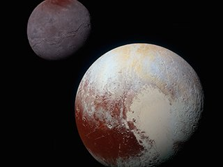 Pluto and Charon: Strikingly Different Worlds